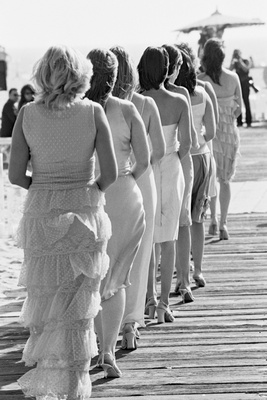 Black and white picture of mismatched bridesmaids on beach