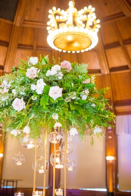 tall floral centerpiece crown shaped chandelier light royalty details wedding reception coronado