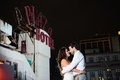 Bride in a strapless Vera Wang gown, beaded sash dances with groom in long white sleeve shirt