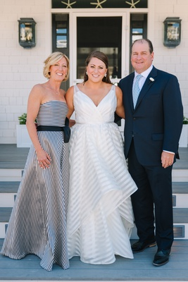 bride in striped hayley paige wedding dress, mother of the bride in black-and-white striped dress