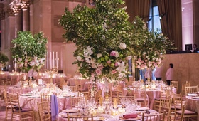 Elegant ballroom wedding with tree and flower centerpieces