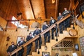 Seven groomsmen and groom on rustic staircase at Villa