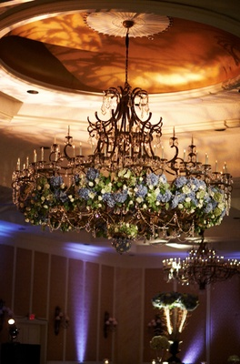 Ballroom wedding chandelier decorated with blue green flowers