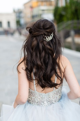 Bride in beaded wedding dress hayley paige long brown hair curled half up half down crystal piece