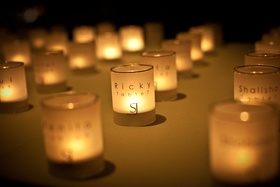 Custom candle votives with wedding table assignments
