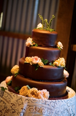 Four layer chocolate brown wedding cake with flowers