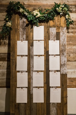 cards on wooden board with green garland