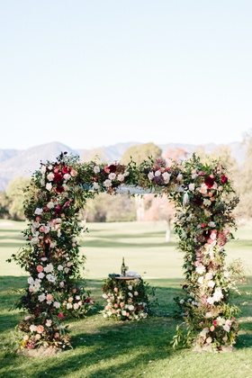 floral chuppah and table during outdoor fall jewish wedding