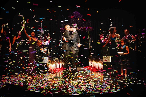 Gay wedding confetti pop as grooms kiss
