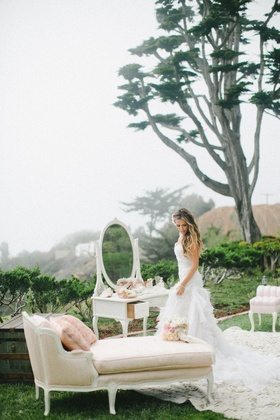 Katrina Hodgson at outdoor bridal suite with antique furniture