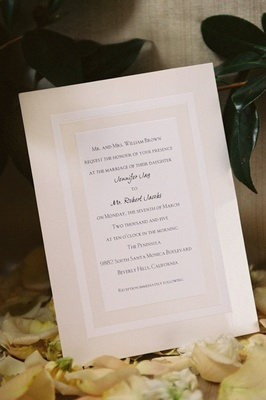 Off-white and cream invitations with border