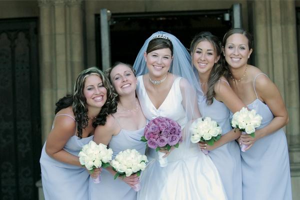 Bride with four bridesmaids in purple bridesmaid dresses