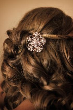 Bride's curls gathered by a rhinestone barette