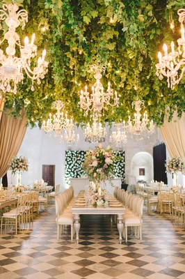 black and white checkerboard floor long tables with tall centerpiece hedge wall flowers colombia