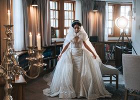 bride in sparkle pnina tornai wedding dress matching over skirt fur cape coat headpiece
