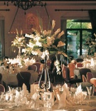Formal indoor reception with tall centerpieces