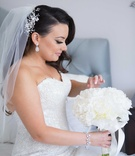 Armenian bride with flower headpiece, bracelet, white peony bouquet with ribbon, teardrop earrings