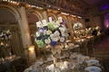 Wedding reception centerpiece candelabra with blue, green, white, and blush flowers