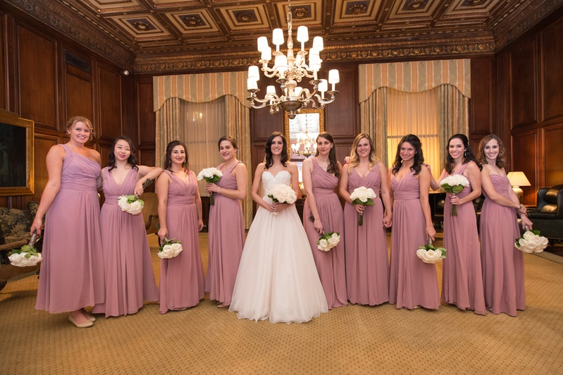 bride in essence of australia wedding dress, bridesmaids in dusty rose monique lhuillier dresses