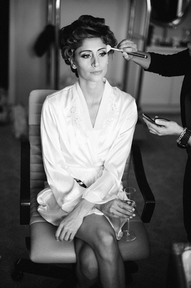 Black and white photo of woman in makeup chair