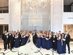 bride in strapless wedding dress groom tuxedo red pocket square bridesmaids in blue groomsmen tuxes