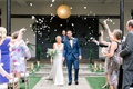 newlyds showered with rose petals during their recessional