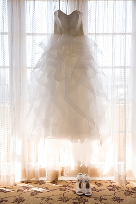 reem acra ball gown with a ruffled tulle skirt in window with aquazarra shoes