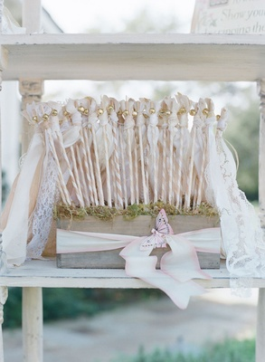 Wood box on bookshelf with lace vintage ribbon wands for ceremony kiss