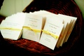 Wedding booklets in wooden basket