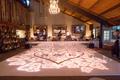 wedding reception dance floor rose gold heart monogram light projections chandelier