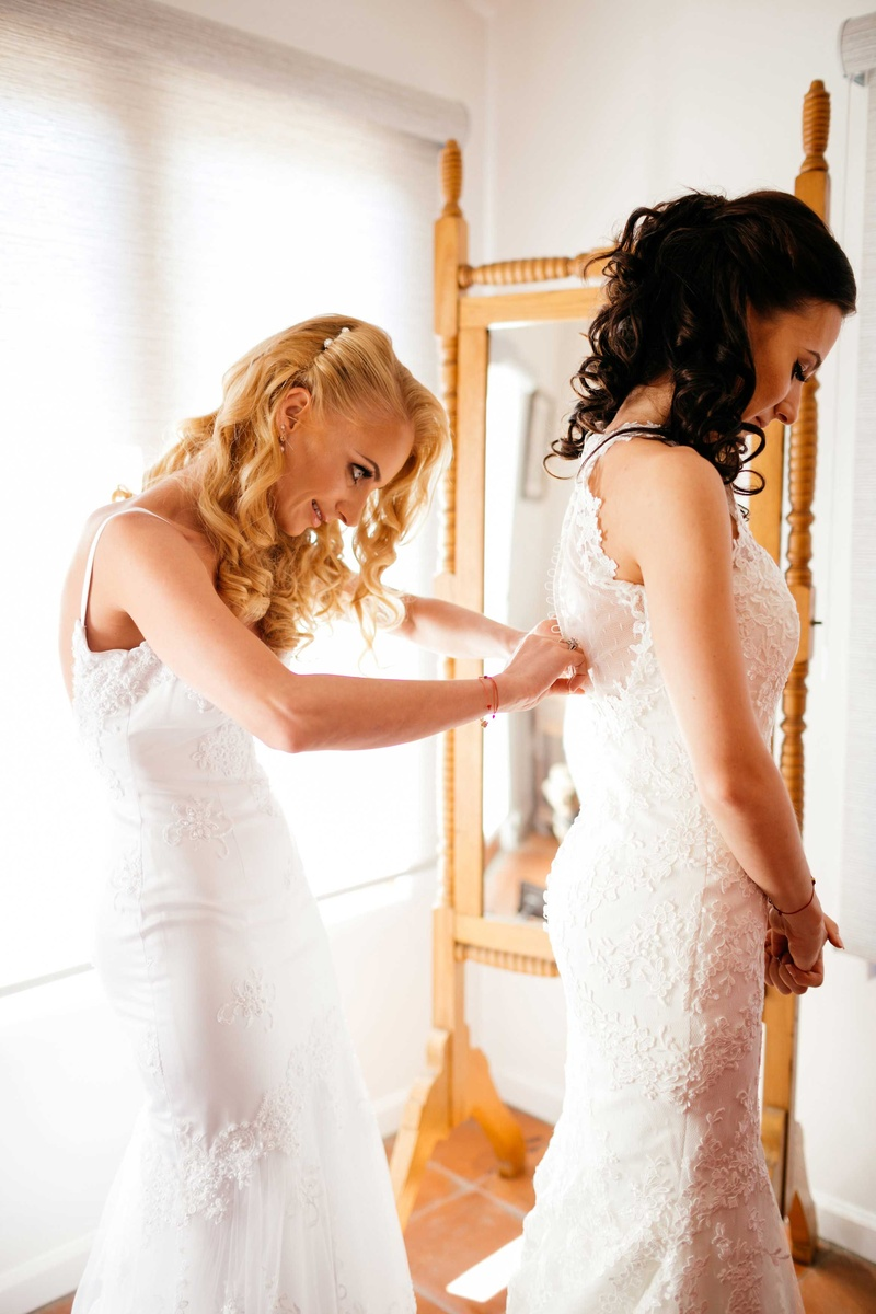 Sisters host double wedding at outdoor venue in malibu california sisters two brides mermaid wedding gowns bride getting ready double wedding junglespirit Gallery