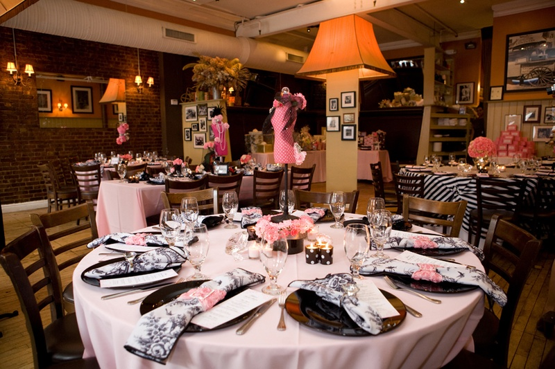 round tables with pink linens with black accents