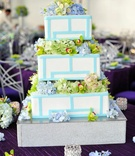 Geometric cake design topped with fresh flowers