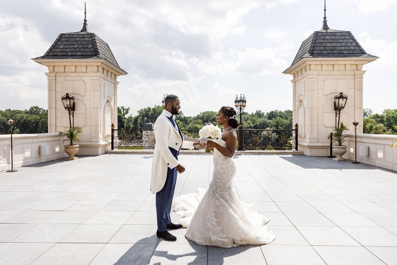 bride and groom first look at the legacy castle outdoor area clouds and regal attire