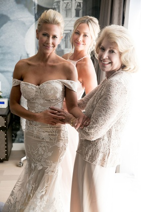 Actress Brittany Daniel in wedding suite off shoulder gown with twin sister Cynthia and mom