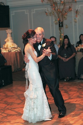 Bride dancing with her dad at reception