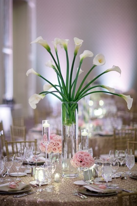 wedding reception centerpiece of calla lilies, small arrangements of pink roses