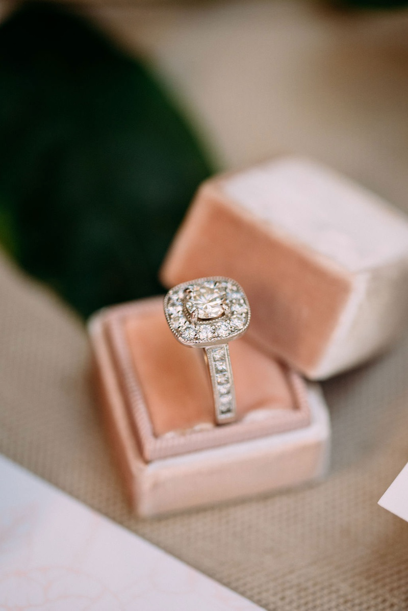 wedding ring engagement ring displayed in velvet blush mrs box diamonds on band and halo
