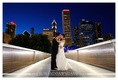 The Nichols Bridgeway is a beautiful place for Samantha and Brian to have their portrait taken on their wedding day.  This is a pedestrian bridge located in Chicago, Illinois. The bridge begins at the Great Lawn of Millennium Park, crosses over Monroe Street and connects to the third floor of the West Pavilion of the Modern Wing, the Art Institute of Chicago's newest wing.
