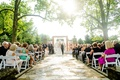 pretty light shining on outdoor wedding ceremony pink flowers cincinnati humidity sunny spring june