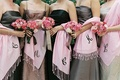 Brown and black gowns with pink shawls