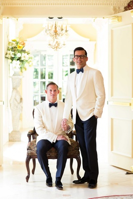 grooms wear white tuxedo jackets and bow-ties portrait