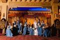 bride in lela rose, bridesmaids in joanna august floor length long blue bridesmaid dresses wrap