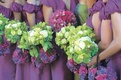 Purple bridesmaid dresses with lime green bouquets