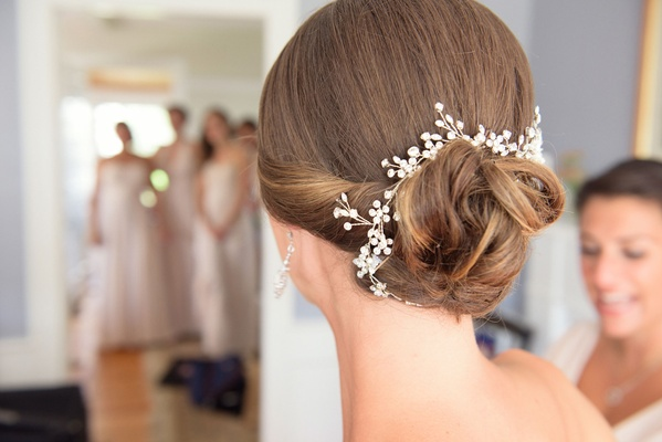 Christie Lauren headpiece in bride's hairstyle low bun brunette