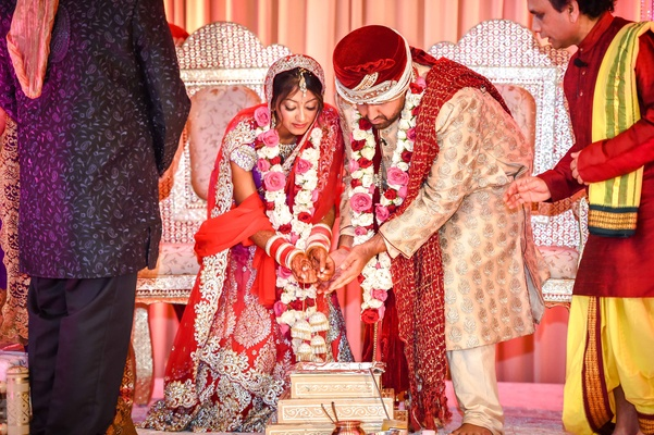 Indian Bride And Groom Marry In Hindu Ceremony