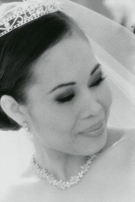 Black and white photo of bride wearing tiara and necklace
