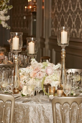 Texture wedding linens with gold candle votives, pillar candles on stands, white, pink flowers