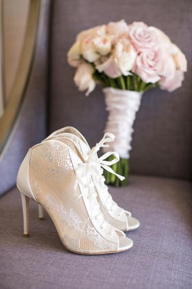 Bride's lace-up booties peep toe wedding heels shoes ivory design pink bouquet