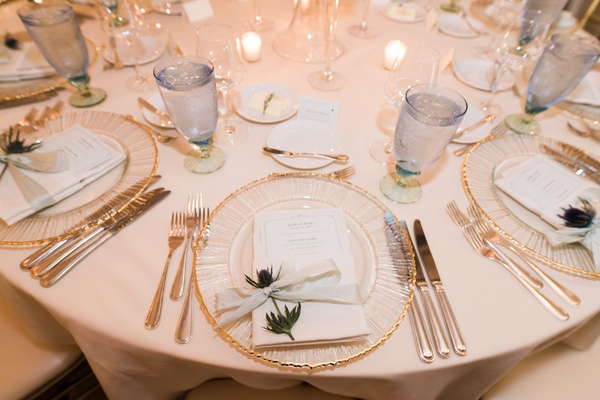 sprig of thistle at each wedding place setting, textured charger with gold rim, pale blue cups